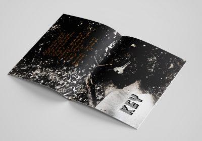 EP Lyric Zine laying flat and open to page with Key lyrics